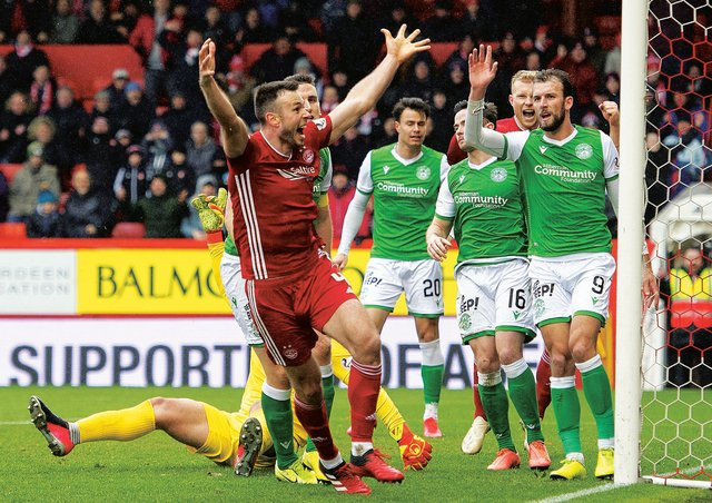 Andrew Considine celebrates putting Aberdeen ahead against Hibernian. Picture: Paul Devlin / SNS