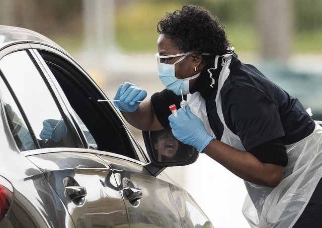 A nurse takes a swab at a Covid-19 drive-through testing station for NHS staff (Picture: Dan Kitwood/Getty Images)