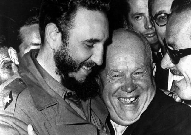 Cuban president Fidel Castro, left, and Soviet leader Nikita Khrushchev hug at the United Nations in this late 1960 file photo. (Picture: Marty Lederhandler/AP)