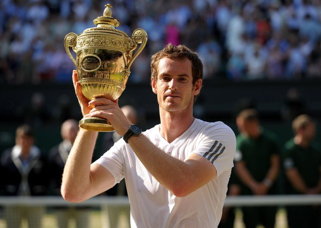 Andy Murray with the trophy after beating Serbia's Novak Djokovic to win the men's singles at Wimbledon in 2013. Picture: Adam Davy/PA Wire