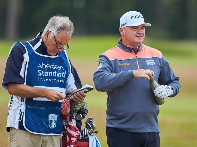 Paul Lawrie, pictured talking over yardage with his caddie Julian Phillips during last year's Aberdeen Standard Investments Scottish Open at The Renaissance Club, believes there are more important things than sport in life at the moment. Picture: Aberdeen Standard Investments