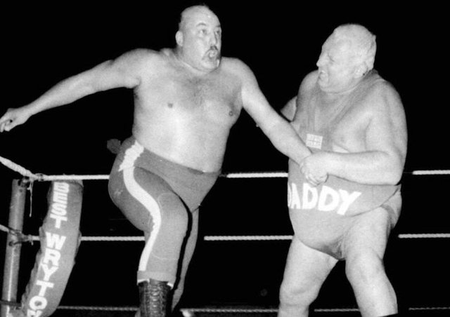Big Daddy, on the right in a bout against Mal Kirk, was a hero of British wrestling in the 1970s