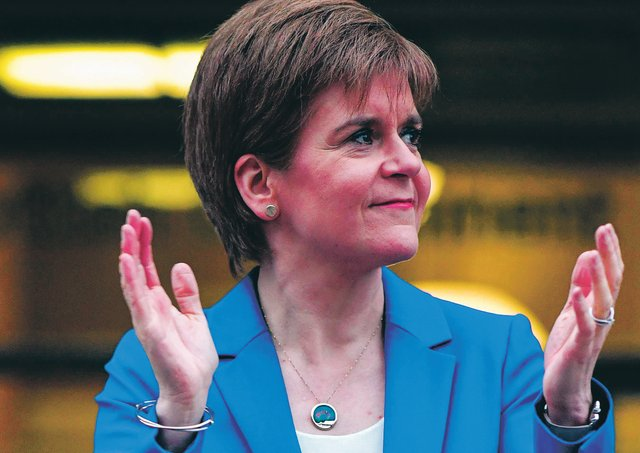 """Scotland's First Minister Nicola Sturgeon takes part in a national """"clap for carers"""" to show thanks for the work of the NHS. Picture: Getty"""