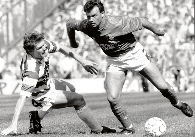 Rangers winger Davie Cooper bamboozles Celtic's Roy Aitken during an Old Firm clash in 1989. Picture: Brian Stewart