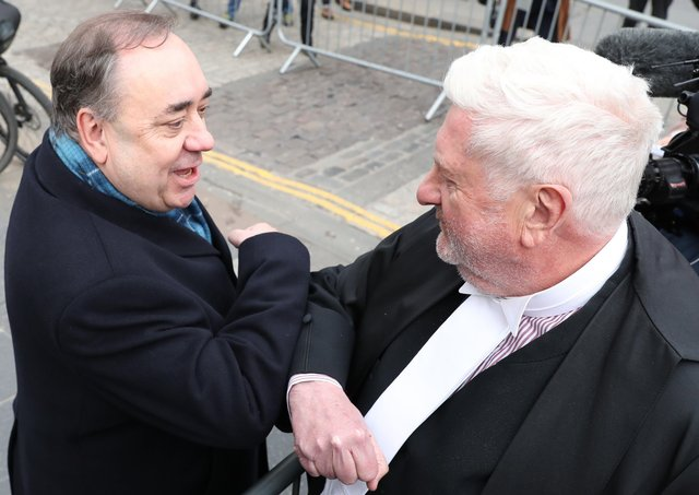 Alex Salmond elbow bumps Gordon Jackson QC as he leaves the High Court in Edinburgh after he was cleared of several sex-offence charges (Picture: Andrew Milligan/PA Wire)