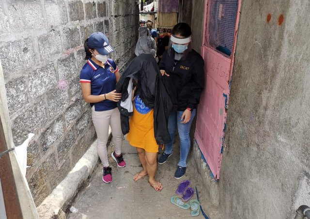 Authorities in Manila rescue a young girl forced to perfrom sexual  acts online for paying customers to watch. The Philipinnes is recognised as a global hotspot for cybersex trafficking
