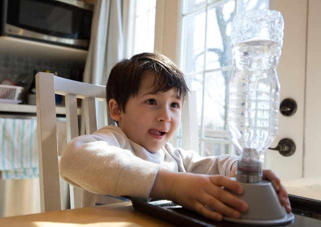 You can recreate a tornado at home, using everyday items from your kitchen, like this little boy