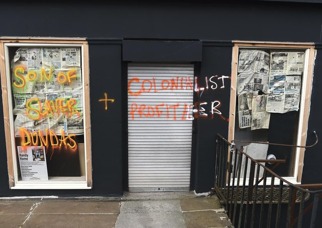 An empty shop was graffitied because it was on Dundas Street (Picture: Lisa Ferguson)