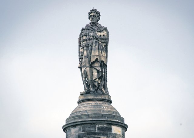 Henry Dundas on his column. Picture: Jane Barlow/PA