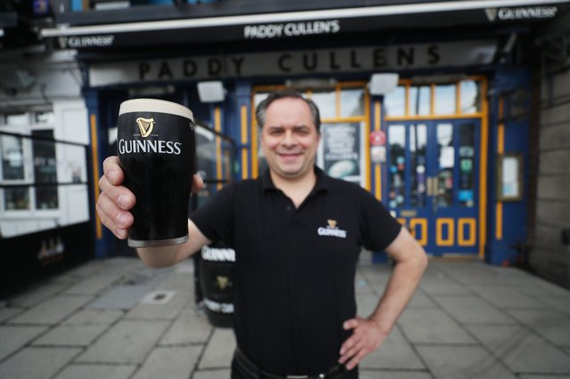Mariusz Brzyk, assistant manager of Paddy Cullens pub in Dublin, takes delivery of fresh Guinness in preparation for bars re-opening in the UK and Ireland. Picture: Niall Carson/PA Wire