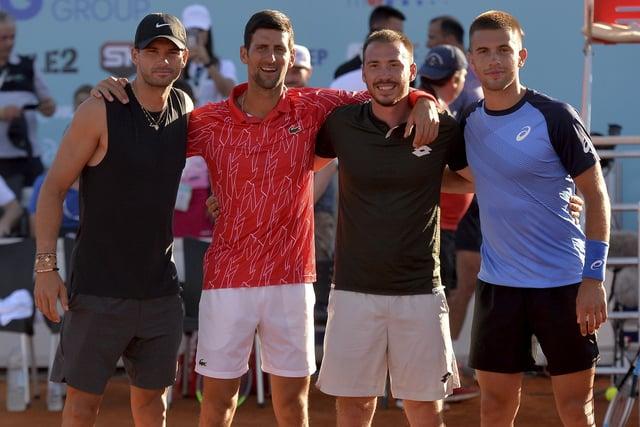 Novak Djokovic, second left, poses with Grigor Dimitrov, left, Viktor Troicki and Borna Coric, right, at the event in Zadar, Croatia. Picture: Zvonko Kucelin/AP