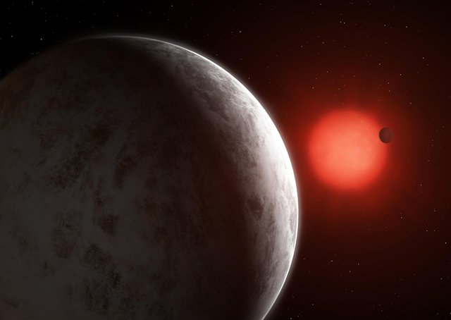 """An artist's impression of the two """"super-earths"""" that have been discovered orbiting one of the brightest red dwarf stars in the sky. Picture: Mark Garlick/PA Wire"""