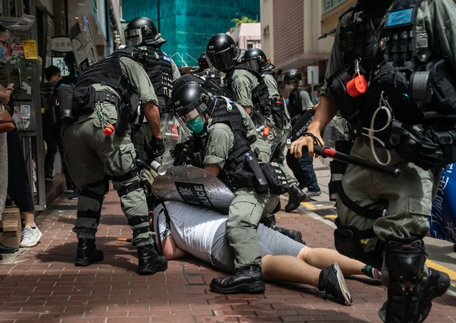A man is detained by riot police during a protest against draconian new laws in Hong Kong (Picture: Anthony Kwan/Getty Images)