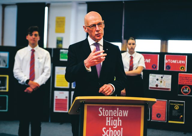 Deputy First Minister of Scotland and Education Secretary John Swinney visits Stonlelaw High School in Rutherglen on the day pupils receive their exam results. Picture: Andy Buchanan - Pool/Getty Images