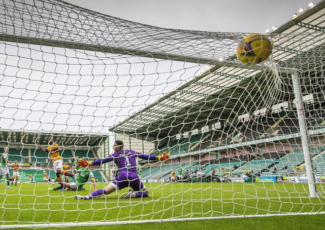 Jordan White's shot deflects off Paul Hanlon before finding the Hibs' net, but Motherwell were denied the goal which was ruled out due to Sherwin Seedorf being offside. Picture: Scottish Sun/Pool/via SNS.