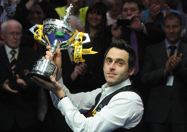 Ronnie O'Sullivan with the world championship trophy. Picture: BBC