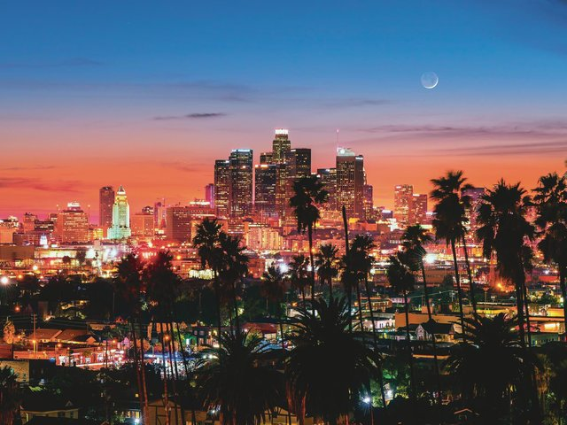 LA is a sprawling mass of a city, with relatively few skyscrapers which are almost exclusively located downtown