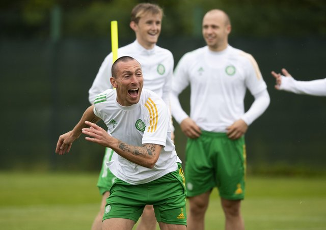 Scott Brown enjoys training at Lennoxtown ahead of the Champions League qualifying tie at Celtic Park. Picture: Craig Foy/SNS