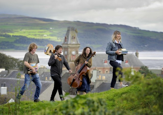 (Left to right) Shaun Bythell, Ben Porter, Beth Porter and Jane Baldwin, at Wigtown's Martyr's Stake in Wigtown Bay. They will all be launching Wigtown Book Festival. Picture: Colin Hattersley/Wigtown Book Festival Company/PA Wire