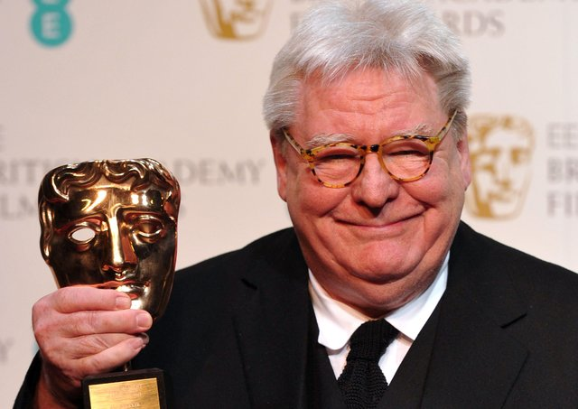 Film director, producer and writer Alan Parker poses with his BAFTA fellowship award in 2013 (Picture Carl Court/AFP via Getty Images)