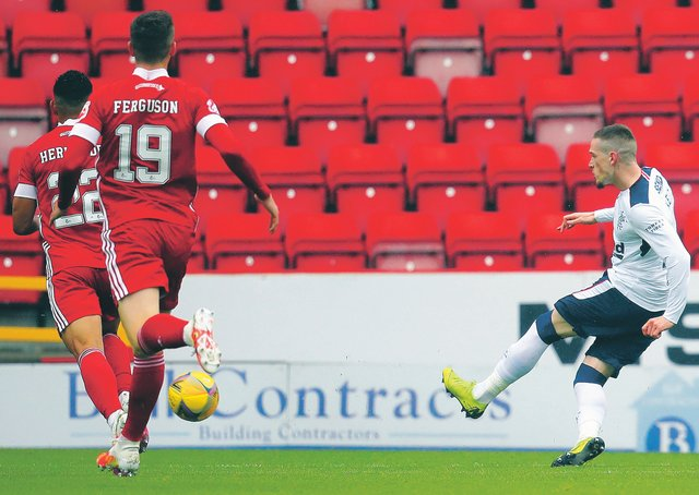 Rangers' Ryan Kent sweeps home the only goal of the game at Pittodrie. Picture: Andrew Milligan/Getty Images