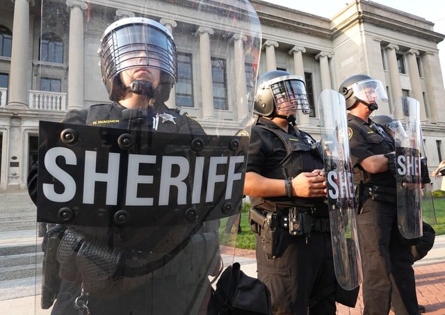 Police stand guard in front of the Kenosha County Courthouse during a second day of unrest on August 24, 2020 in Kenosha, Wisconsin.