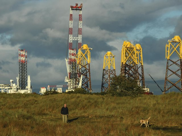 Foundations for an offshore wind farm float in The Cromarty Forth. Locals are accustomed to the sight of oil rigs moored up for maintenance, but moves to more renewables will transform the area, and the Scottish economy. Picture: Getty Images