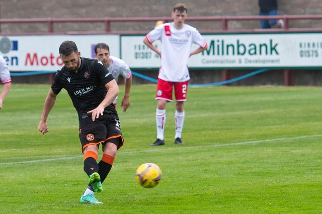 Dundee United's Nicky Clark completes his hat-trick from the penalty spot.