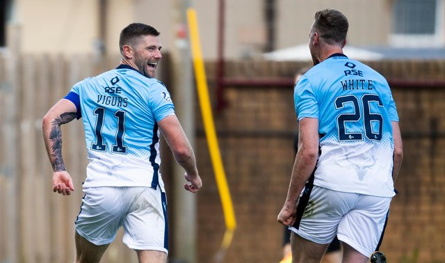 Iain Vigurs celebrates after firing Ross County level. Picture: SNS