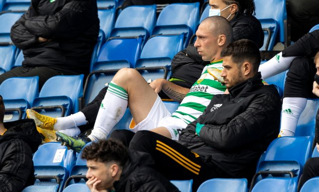 Celtic captain Scott Brown cuts a disconsolate figure as he sits in the stand after being substituted to bring a sorry end to his last experience of the club's jousts with Rangers. (Photo by Craig Williamson / SNS Group)