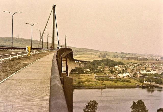 Looking north across the Erskine Bridge east footway in July 1971. Old Kilpatrick ferry terminal visible.
