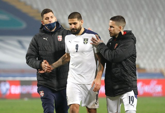 Aleksandar Mitrovic is consoled - but he was not the brunt of the blame in the Serbian press following the defeat  (Photo by Srdjan Stevanovic/Getty Images)