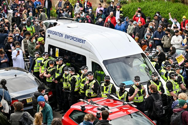 Protesters block a UK Home Office van to prevent it leaving Kenmure Street in Glasgow