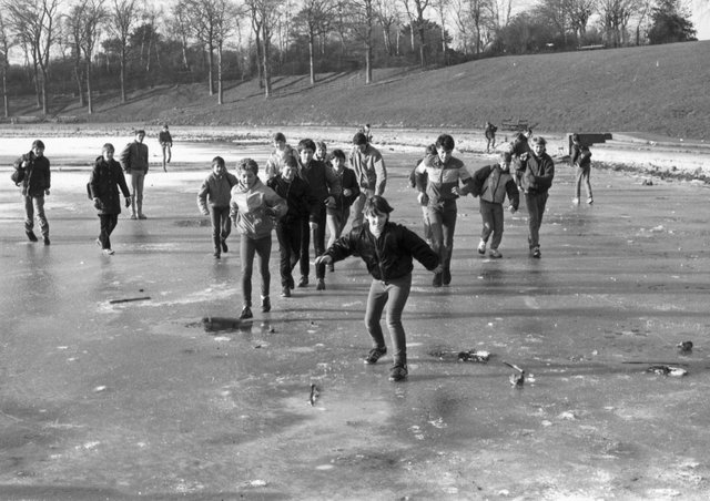 Children sliding on a frozen Inverleith pond, iced over during the cold weather in February 1985.