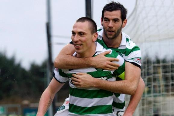 Celtic captain Scott Brown celebrates with team-mate Joe Ledley back in 2012. Both are among ITV analysts for Euro 2020. (Picture: SNS)