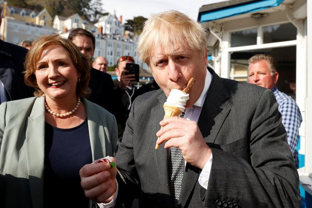 Boris Johnson eats an ice-cream as he visits Llandudno in Wales (Picture: Phil Noble/PA Wire)