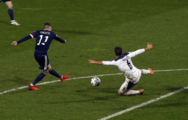 Ryan Christie scores against Serbia as Scotland secured a place in next year's delayed Euro 2020 championship to the delight of millions of people (Picture: Novak Djurovic/PA Wire)