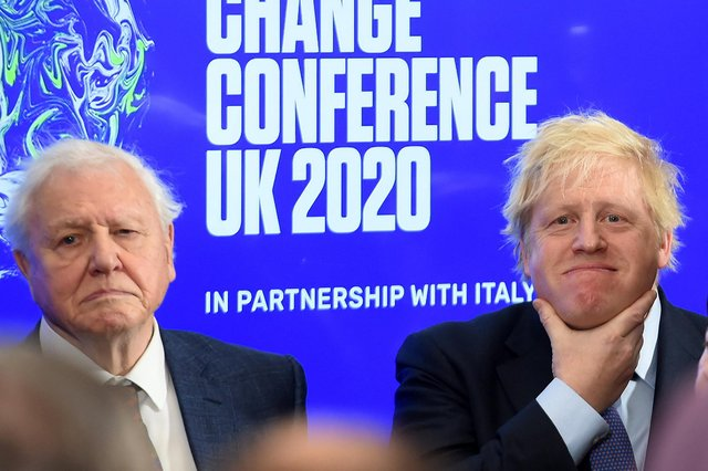 Boris Johnson and broadcaster and conservationist David Attenborough at the launch of the United Nations' Climate Change conference, Cop26, in London in February last year (Picture: Jeremy Selwyn/pool/AFP via Getty Images)