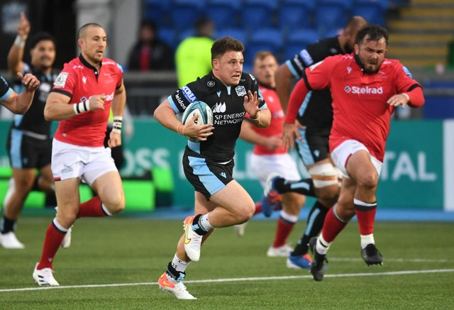 Glasgow Warriors' Duncan Weir runs through for the opening try against Newcastle Falcons. Picture: Ross MacDonald/SNS