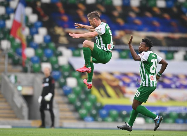 Former Hearts winger Saulius Mikoliunas leaps in celebration after scoring for the Zalgiris in their Champions League first qualifying round victory against Linfield at Windsor Park on Tuesday night. (Photo by Charles McQuillan/Getty Images)