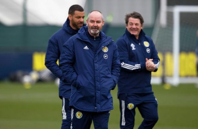 Scotland manager Steve Clarke with his assistants Steven Reid (left) and John Carver (right).  (Photo by Craig Williamson / SNS Group)