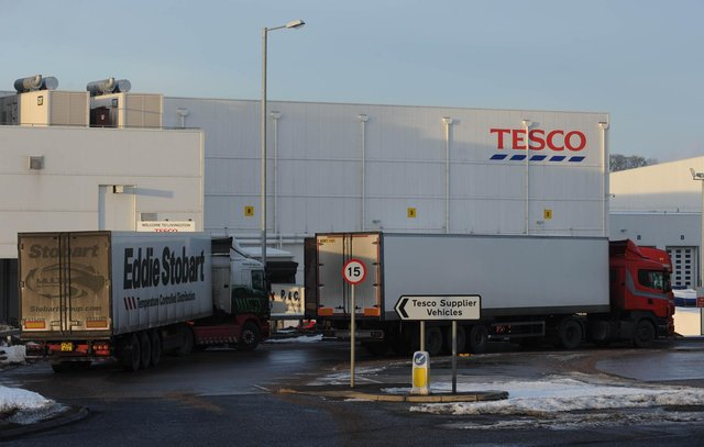 Up to 290 staff at Tesco's Livingston distribution centre are affected by the pay cut plan