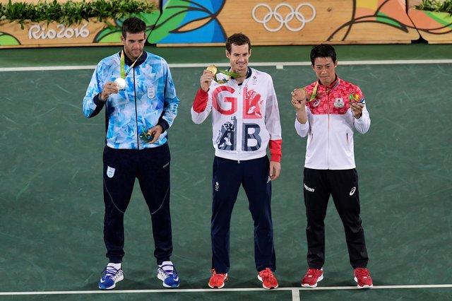Andy Murray, centre, shows off his gold medal at the Rio 2016 Olympic Games.