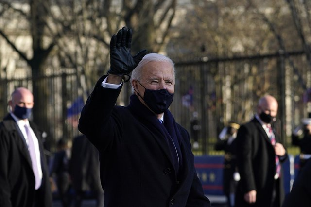 Joe Biden walks the parade route after his inauguration