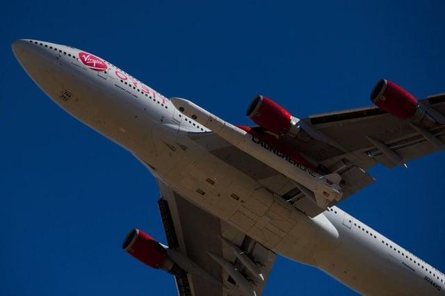 The Virgin Orbit - a modified Boeing 747 - carries a Launcher One rocket under it's wing containing small satellites to be sent into space. (Pic: Getty)  - b25lY21zOjAwYWY1ZDMxLTY0MjEtNDRkOC1hOWU3LTZlMjkwM2NiMDAzYjoxZmQyNGZjYi1lOGU4LTRmOWQtOTcwNC1hMjRhZDYxNmJhZmQ  - Who owns Virgin Orbit? The rocket company is launching satellites into space – here's why