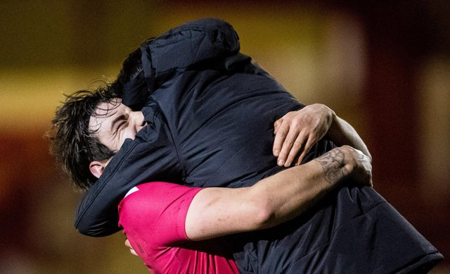Brora manager Steven MacKay (R) and his players celebrate at full time during a Scottish Cup tie between Brora Rangers and Hearts at Dudgeon Park, on March 23, 2021, in Brora, Scotland. (Photo by Ross Parker / SNS Group)