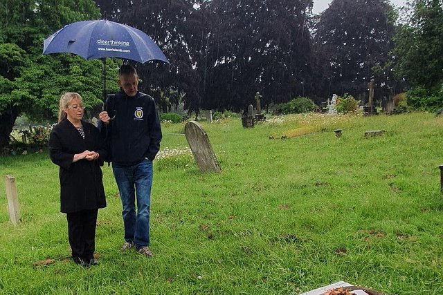 Scotland fan Alistair Firth with Emma Wilson from the Richmond cemetery office