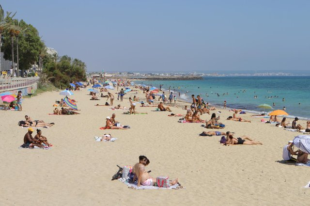 People socially distancing on Palma's City Beach. Picture: Ruairidh Mason