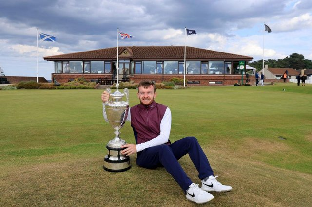 Laird Shepherd poses with the trophy after his victory in the final of the R&A Amateur Championship at Nairn. David Cannon/R&A/R&A via Getty Images.