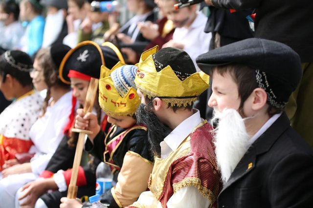 Jewish school children gather and sit in fancy dress during a schools' annual Purim event (Photo: Shutterstock)